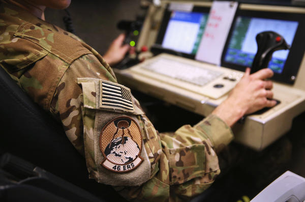 A pilot prepares to launch an unmanned aerial vehicle from a ground control station earlier this year. The Air Force is moving to treat psychological stress faced by remote pilots and analysts a little more like the effects of traditional warfare.