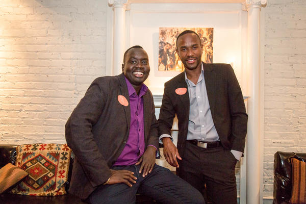 Manyang Reath Kher (left) came to the U.S. as a teenage refugee, one of the so-called Lost Boys of Sudan. Today he runs a nonprofit called Humans Helping Sudan. He's pictured with the organization's operations manager, Elvis Hedji.