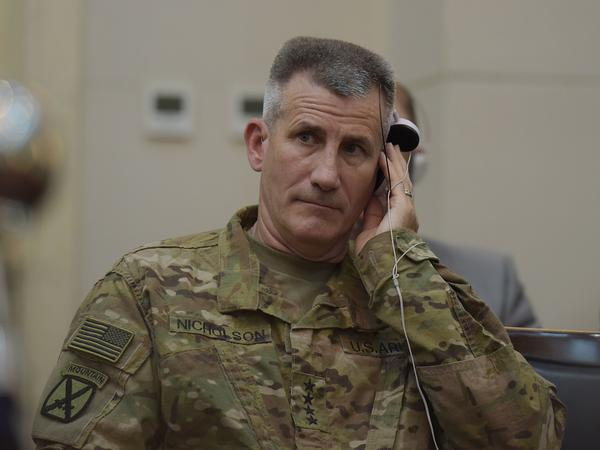 Nicholson listens to Afghan President Ashraf Ghani during a joint press conference with then-Defense Secretary Ash Carter in Kabul in 2016.