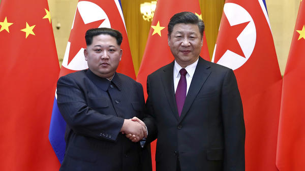 North Korean leader Kim Jong Un and Chinese President Xi Jinping shake hands in Beijing, in this photo provided by China's Xinhua News Agency in Beijing. Kim was making his first known trip to a foreign country since he took power in 2011.