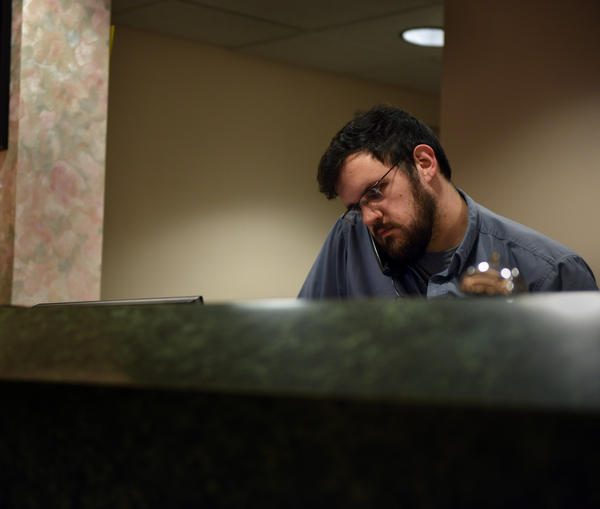 Brad Pennington, 23, works at a hotel in Grundy, Va. Without a college degree and no interest in working in coal, Pennington saw a dim future if he stayed.