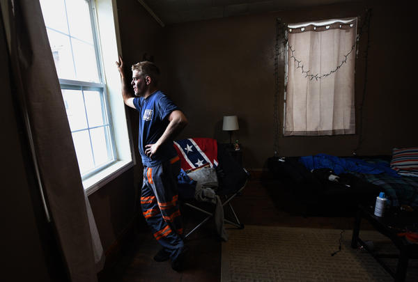 Johnson in his apartment in Honaker, Va. He says the Confederate flag to him is not about slavery but history and the fact that Virginia fought in the Civil War.