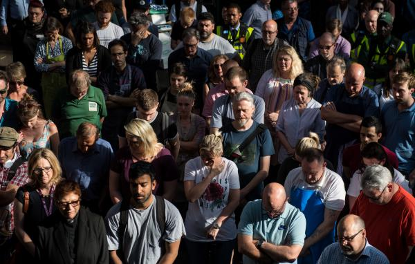 A Borough Market trader wipes away a tear as she and other traders observe a minute of silence for the victims of the London Bridge terror attack, at Borough Market on Saturday. The traders gathered at the end of the trading a day ahead of the first anniversary of the London Bridge attack.