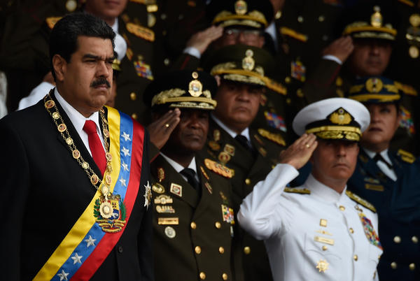 "Venezuelan President Nicolas Maduro, left, survived an ""attack"" during a ceremony to celebrate the 81st anniversary of the National Guard in Caracas on Saturday."