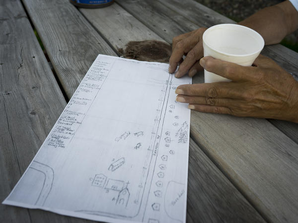 Mike LaGrew explains where people lived along the banks of the Bad River in Old Odanah. Scientists trying to understand and quantify the effects of the town's move are using everything from hand-drawn maps to satellite images in their analysis.