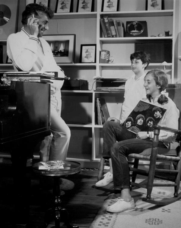 Leonard Bernstein with daughter Jamie and son Alexander, listening to The Beatles.