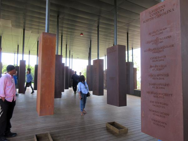Visitors at the National Memorial for Peace and Justice in Montgomery, Ala. The memorial includes some 800 markers, one for each county in the U.S. where lynchings took place, documenting the killings of more than 4,400 individuals between 1877 and 1950