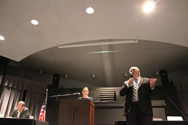 Republican incumbent Ron Estes gives his closing remarks as Democratic candidate James Thompson listens during a forum Thursday at Pratt Community College.