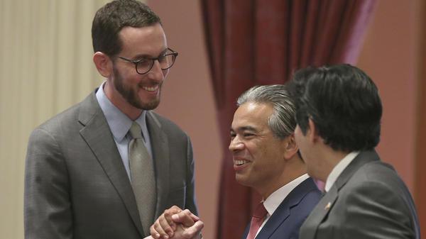 State Sen. Scott Wiener, D-San Francisco, left, receives congratulations from Assemblyman Rob Bonta, D-Alameda, center, and Sen. Kevin de Leon, D-Los Angeles, right, after passage of the bill Friday in Sacramento.