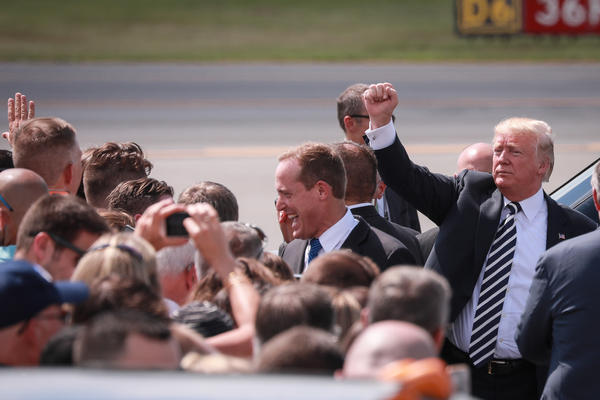 President Trump gestured to a crowd of supporters at Charlotte Douglas International Airport Friday, Aug. 31, 2018.