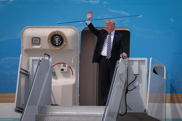President Trump waves from Air Force 1 at Charlotte Douglas Airport Friday, Aug. 31, 2018.