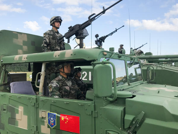 Chinese soldiers display armored vehicles during multinational exercises at the Chebarkul tank range in Russia.