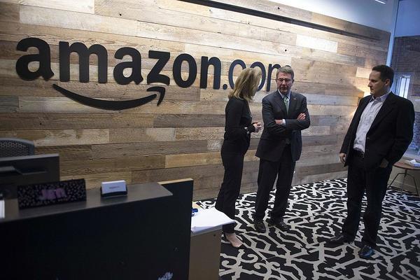 Then-U.S. Defense Secretary Ash Carter (center) tours Amazon's headquarters in Seattle in 2016.