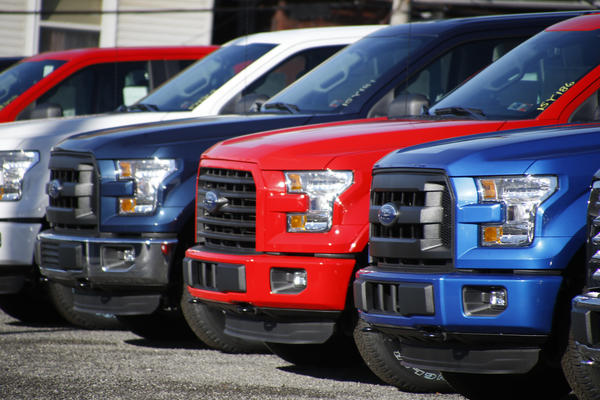 A row of 2015 Ford F-150 pickup trucks parked at a sales lot in Butler, Pa.