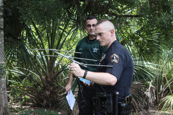 Joel Quattlebaum, Largo Police Department's senior services officer, training on how to use the SafetyNet system to locate a missing person.