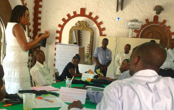 University of Miami psychology professor Guerda Nicolas (left) training Haitians in mental health awareness in Akaye, Haiti, in 2013.