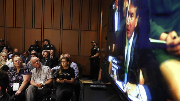"""Wearing a """"Women For Kavanaugh"""" T-shirt, Annabelle Rutledge watches with others as  Kavanaugh testifies on Wednesday."""