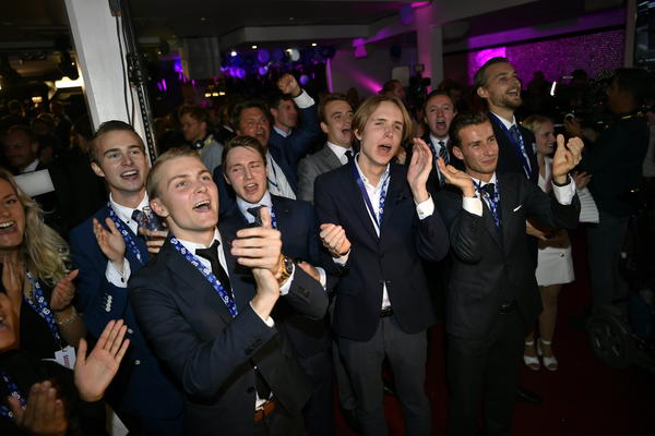 Supporters of the Sweden Democrats react in jubilation during an election night event in Stockholm on Sunday, after an exit poll showed the anti-immigrant party making gains.