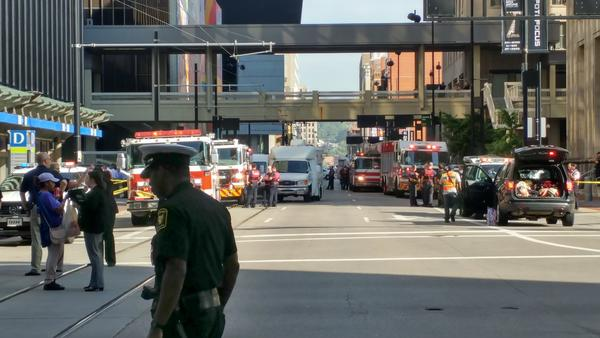 Emergency vehicles line Walnut outside the Fifth Third Center after the shooting.