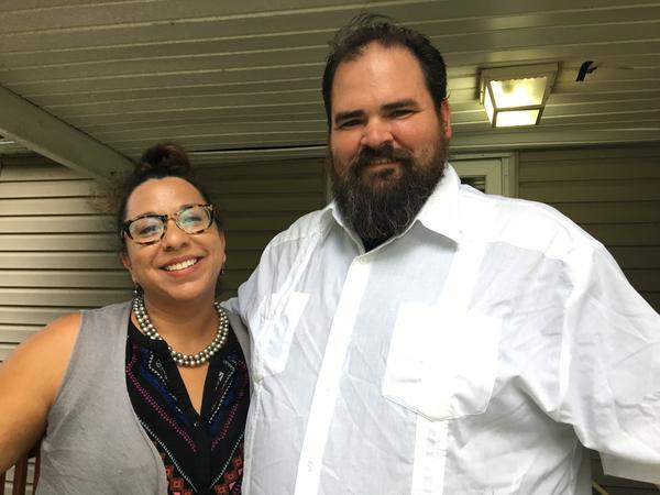 Jessica Salazar Collins and Josh Collins, a couple who whose Bank of America account was frozen when they ignored a question about citizenship, on the front porch of their Roeland Park home.