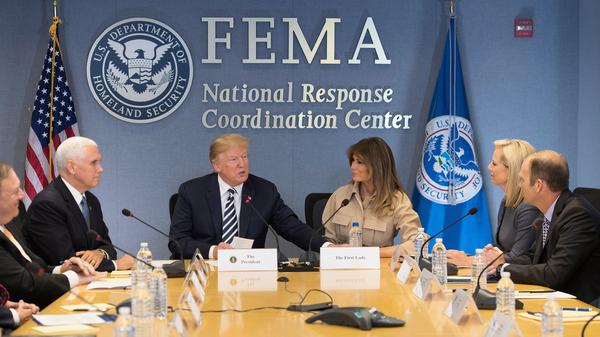 President Trump, Vice President Pence and first lady Melania Trump visit the Federal Emergency Management Agency headquarters in Washington, D.C., on June 6. Secretary of Homeland Security Kirstjen Nielsen and FEMA Administrator Brock Long are seated at right. This summer, DHS transferred nearly $10 million from FEMA to immigration authorities, according to a congressional document.