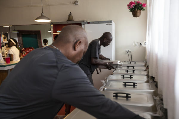 Tim Ragin and Kendall Jackson help prepare for dinner at Haso Ministries in Wilmington, N.C., on Thursday. Typically, Haso (Help A Sister Out) Ministries feeds the hungry in the Northside neighborhood every other Tuesday. During the course of Hurricane Florence the ministry plans to feed the neighborhood three meals a day until it runs out of food or power.