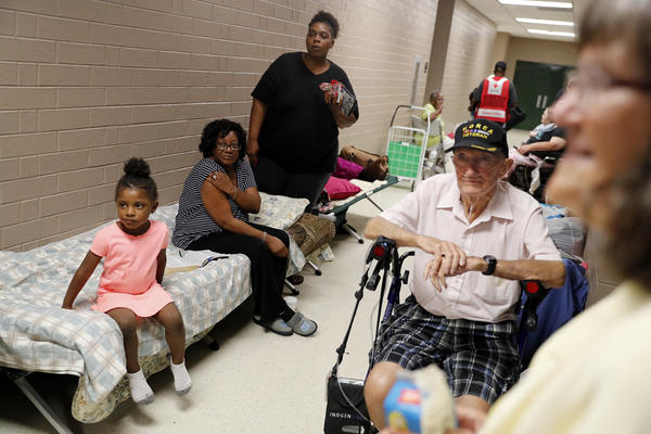 Keymoni McCleod, 4, (left) her great-aunt Ernestine McCleod, and her mother, Markia McCleod, wait in a shelter with Ed Coddington, a Korean War veteran, and his wife, Esther, after evacuating from their nearby homes in Conway, S.C., on Wednesday.