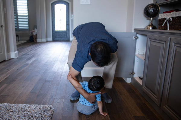 Khan picks up his youngest child at their home.