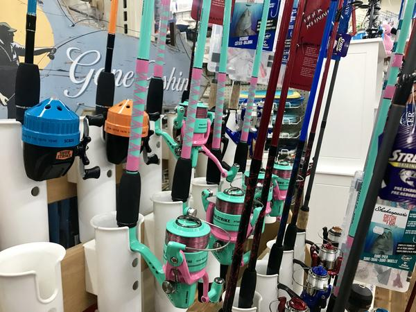 Fishing poles await tourists at Bailey's General Store on Sanibel