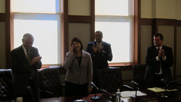 Lisa Freeman displays gratitude after the vote to enter contract negotiations for the NIU presidency