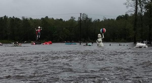 Fiberglas figures appeared to be swimming in floodwaters off US 74 in Columbus County.