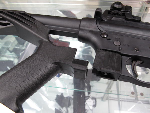In this Feb. 1, 2013 file photo - taken at North Raleigh Guns in Raleigh, N.C. - a bump stock is placed near a disassembled .22-caliber rifle. Bump stocks will be banned in Vermont effective Oct. 1. People can voluntarily turn over bump stocks to the VSP.