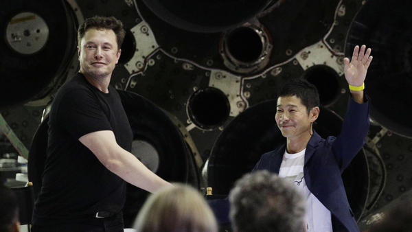 SpaceX founder and chief executive Elon Musk, left, shakes hands with Japanese billionaire Yusaku Maezawa, right, on Monday, after announcing that he will be the first private passenger on a trip around the moon.
