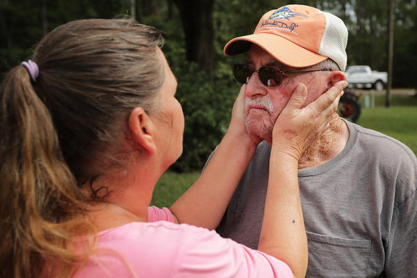 George Skinner, 83, is comforted by his neighbor Mary Ann Dunn after their homes were damaged by floodwaters from the Nuese River in Kinston, N.C., on Monday. Since the creek behind his home first overflowed during Hurricane Floyd in 1999, Skinner said each subsequent storm has produced worse flooding. After Hurricane Florence, his whole family is leaving and does not plan on returning.