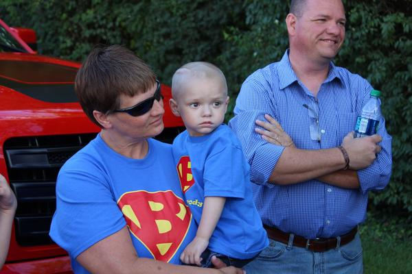 Brody and his parents, mom Shilo and dad Todd, wait for the parade to start.