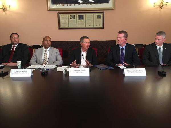 Gov. John Kasich (middle) sits down with Karhlton Moore, executive director of the Office of Criminal Justice Services (left); and John Born, director of the Ohio Department of Public Safety (right).