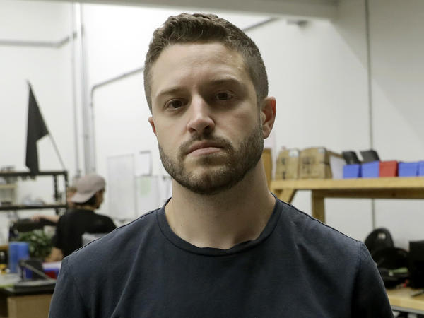 Cody Wilson, founder of Defense Distributed, holds a 3D-printed gun called the Liberator at his shop, in Austin, Texas, last month. On Tuesday, the company announced Wilson resigned and severed all ties with the company on Sept. 21.