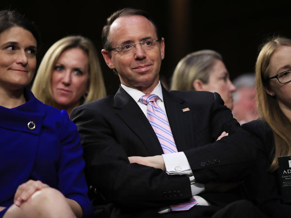 Deputy Attorney General Rod Rosenstein, center, may get a reprieve after a scare this week in which he expected to be fired.
