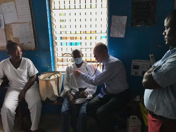 Dr. Paul Farmer examines a tuberculosis patient in Monrovia, Liberia.
