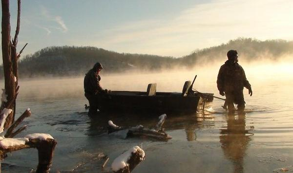 Duck hunters set out on the Ohio River in the early morning hours this winter in Gallipolis.