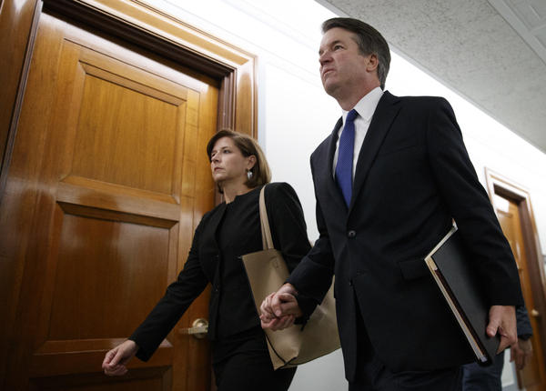 Kavanaugh and his wife, Ashley, hold hands as they arrive for the hearing.
