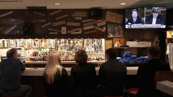 Patrons at Chicago's Billy Goat Tavern watch the Senate Judiciary Committee hearing on sexual abuse allegations against Supreme Court nominee Brett Kavanaugh on Thursday.