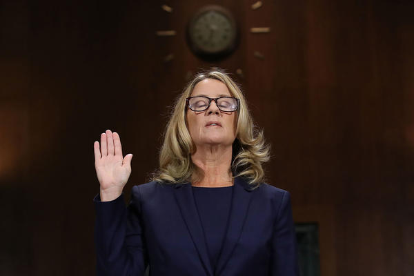 Christine Blasey Ford is sworn in ahead of testifying before the Senate Judiciary Committee on Thursday.