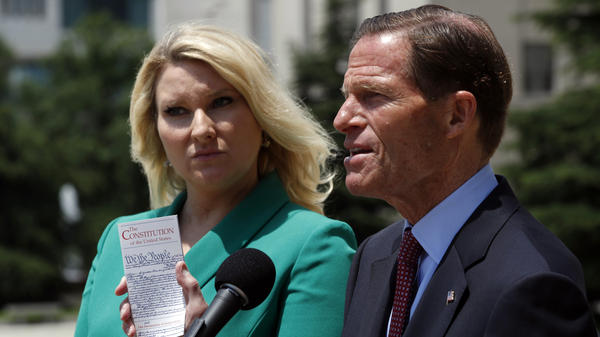 Sen. Richard Blumenthal, D-Conn. (right) and Elizabeth Wydra, congressional Democrats' attorney in a case accusing President Trump of violating the Constitution's Foreign Emoluments Clause, speak to reporters in June.