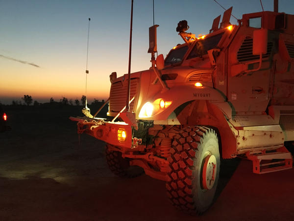 A MaxxPro mine-resistant vehicle transports forces at Qayyarah West.