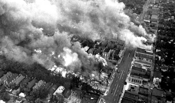 On July 24, 1967, multiple fires burn about three miles west of the downtown area.