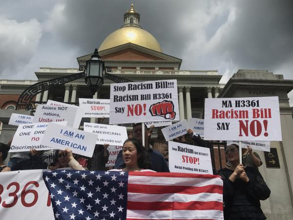 Protesters gather outside the Massachusetts State House in Boston for a July 28 demonstration against a bill that would require state agencies to collected detailed data on Asian-Americans and Pacific Islanders.