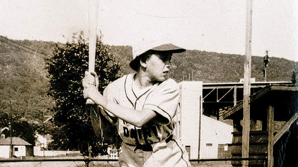 """A 1950 photo of Kay (aka """"Tubby"""") Johnston in her King's Dairy Little League team uniform hangs in a special exhibit honoring women in baseball, at the National Baseball Hall of Fame in Cooperstown, N.Y."""