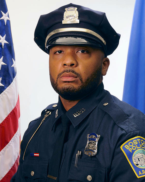 Boston Police Officer Dennis Simmonds, seen in undated portrait, was among the officers at the scene in Watertown, Mass., in the early hours of April 19, 2013, when the Boston Marathon bombers were engaged in a shootout with police. His death, in April 2014, was linked to head injuries he sustained when an explosive thrown by one of the Tsarnaev brothers detonated near him.