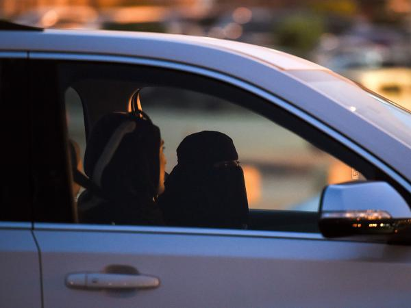 A Saudi woman sits in the driver's seat with a Lebanese driving instructor as they test-drive a car during an automotive exhibition for women in the capital Riyadh on May 13.